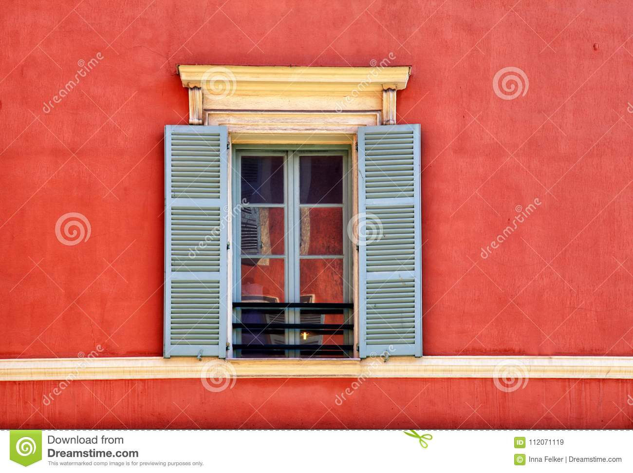 Vintage window with grey shutters in old red stucco house, Nice, France