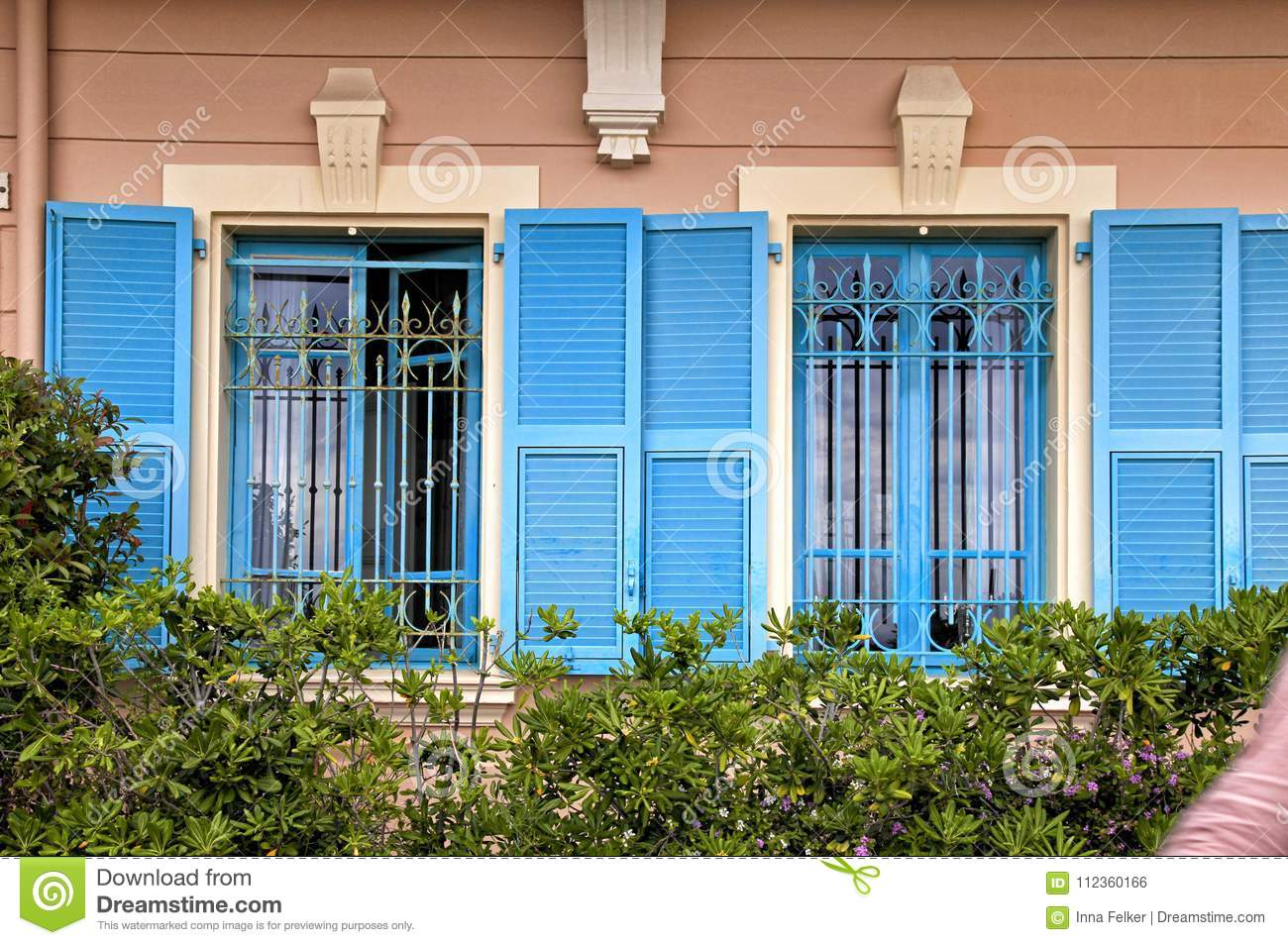 Vintage windows with blue shutters in old house, Provence, Franc