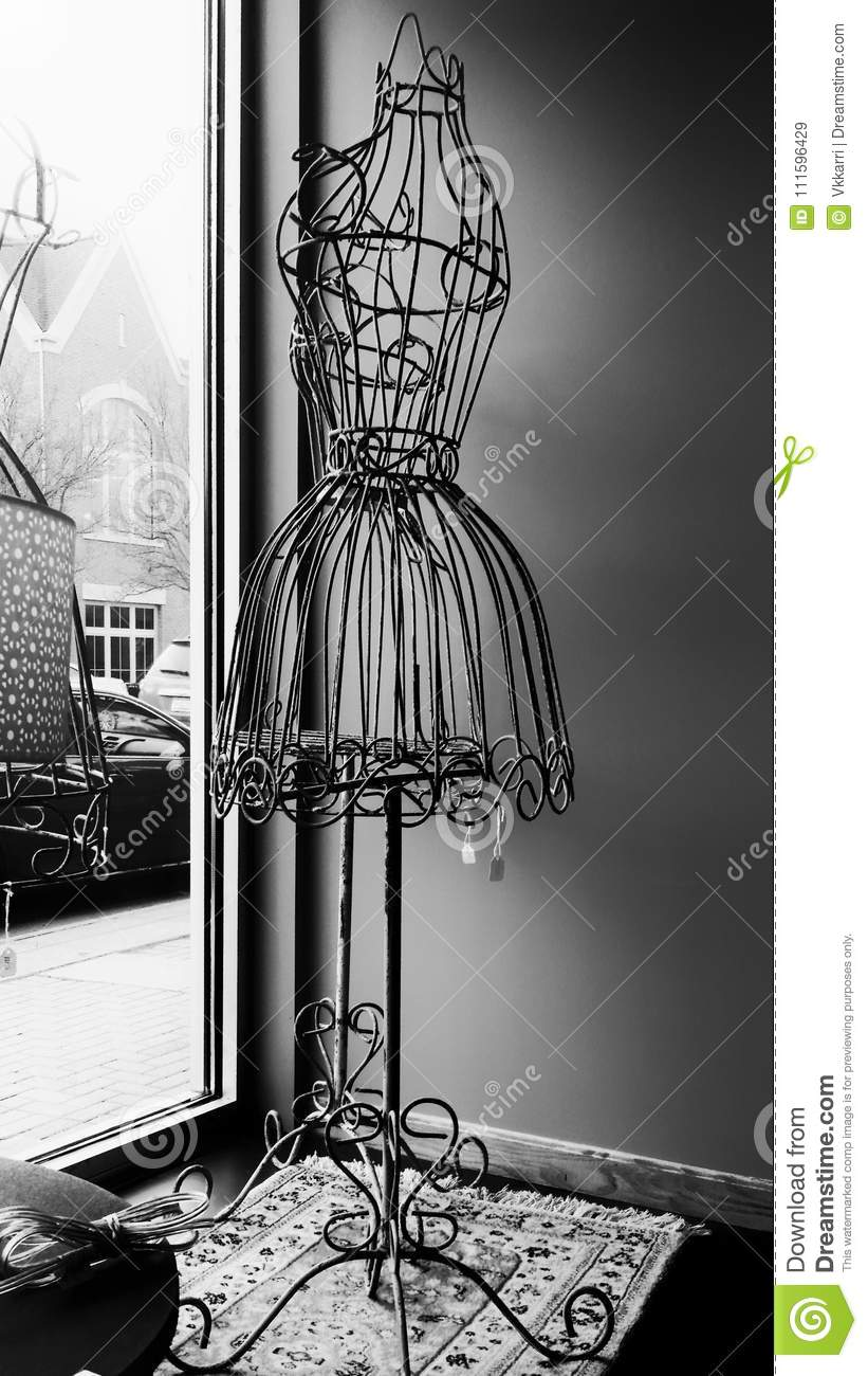 Vintage Wire Form Figure In Window Stock Image - Image of fashion ...