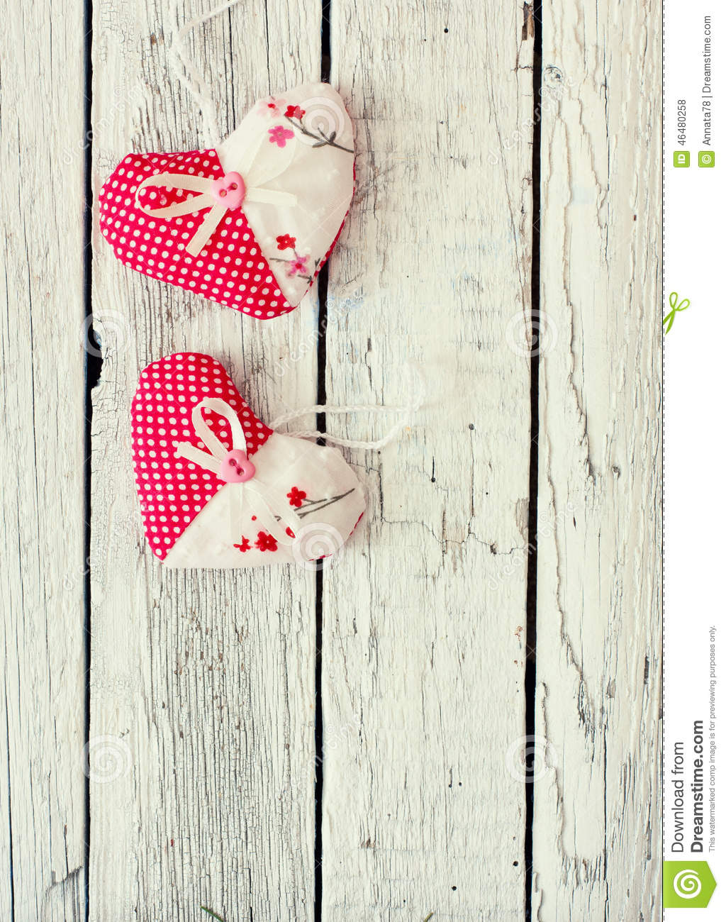 Vintage wood background with decorative hearts
