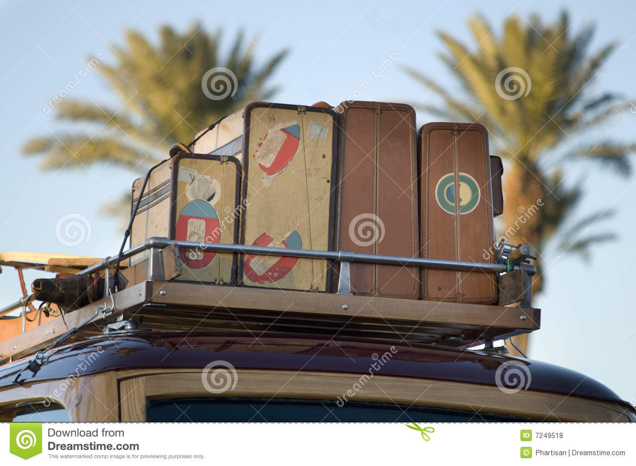 Vintage Wood Car With Old Travel Suitcases Stock Photo