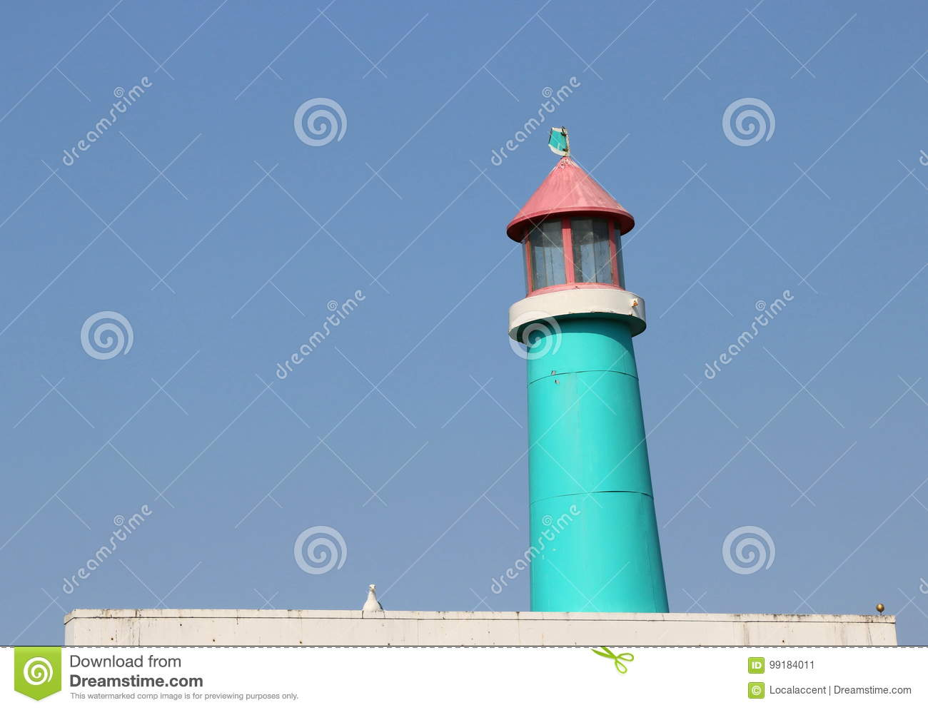 Vintage, wooden blue and pink lighthouse.