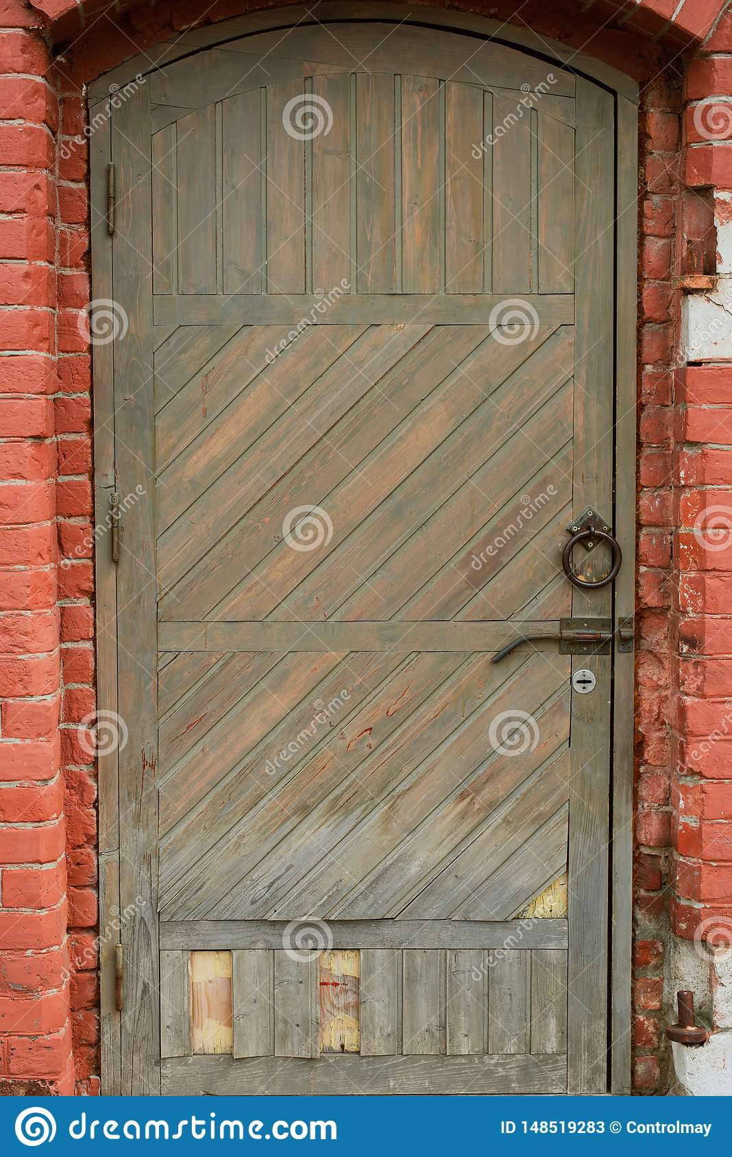 Old wooden door with a lantern above it