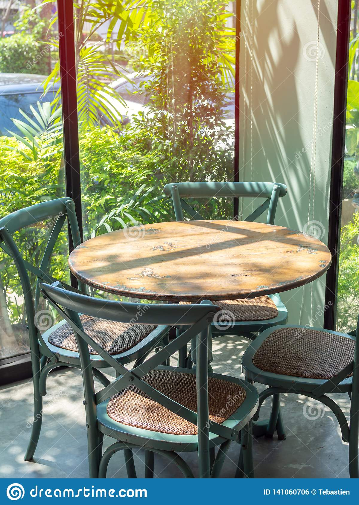 Astounding Vintage Wooden Table Set In Glass Room Near The Garden Stock Machost Co Dining Chair Design Ideas Machostcouk