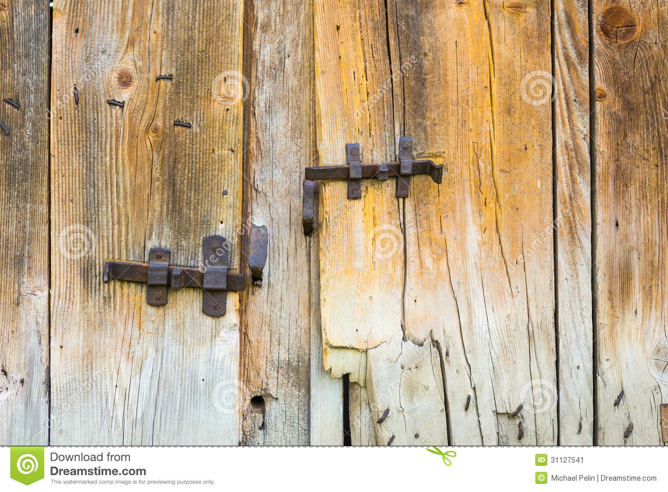 Vintage Wrought Bars On Wooden Barn Doors Stock Image
