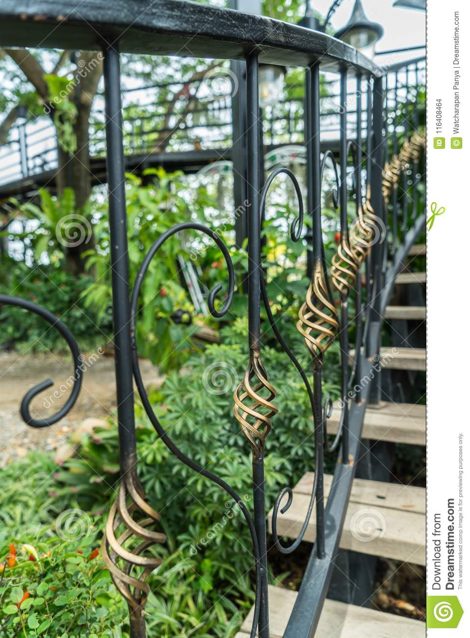 A Detail Of Curved Metal Railing At Outdoor Stairs Stock ...