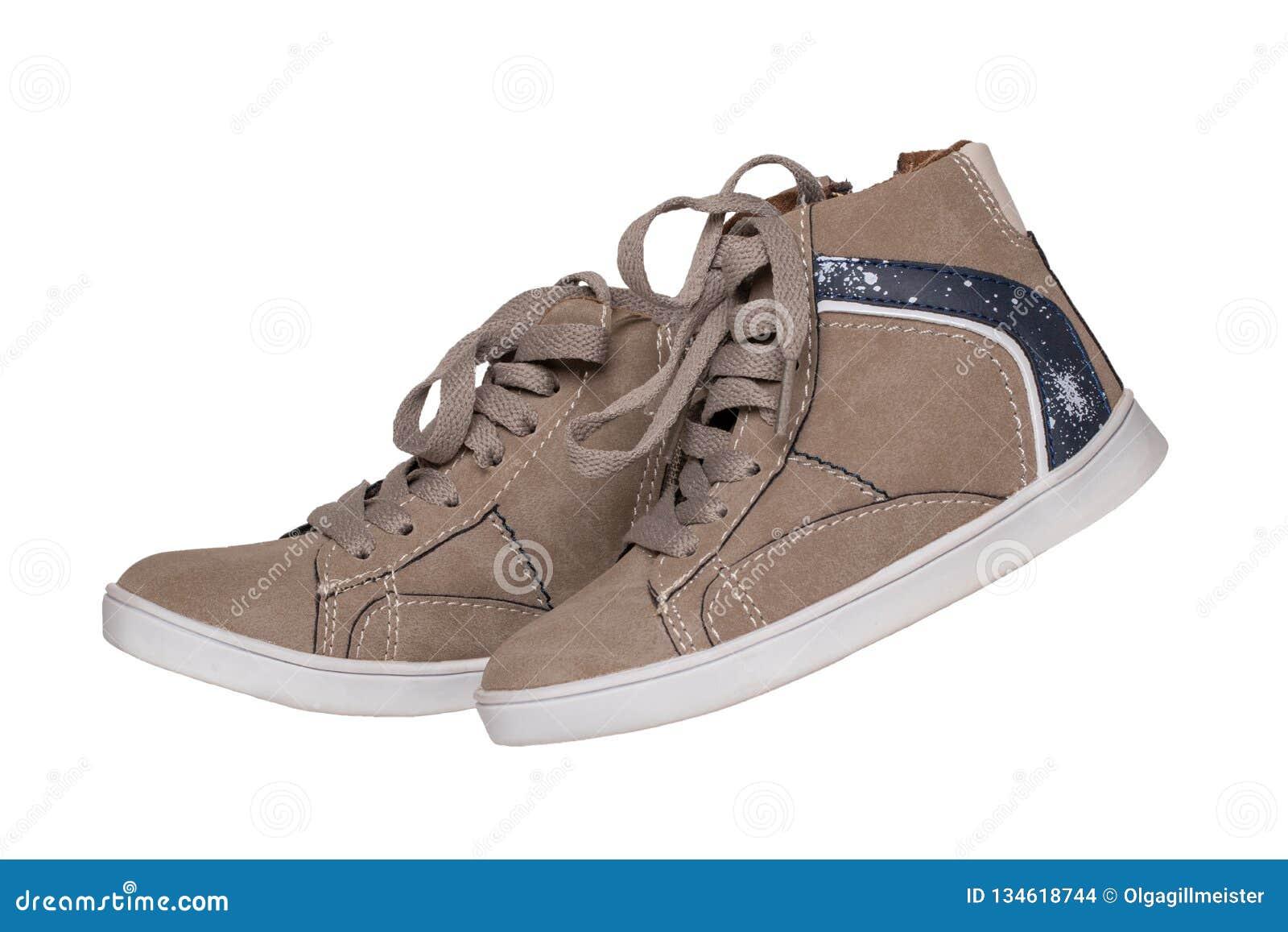 Vinterkängor och skor Kängor för en vinter för parbruntmockaskinn som isoleras på en vit bakgrund Vinter för samling för mode för