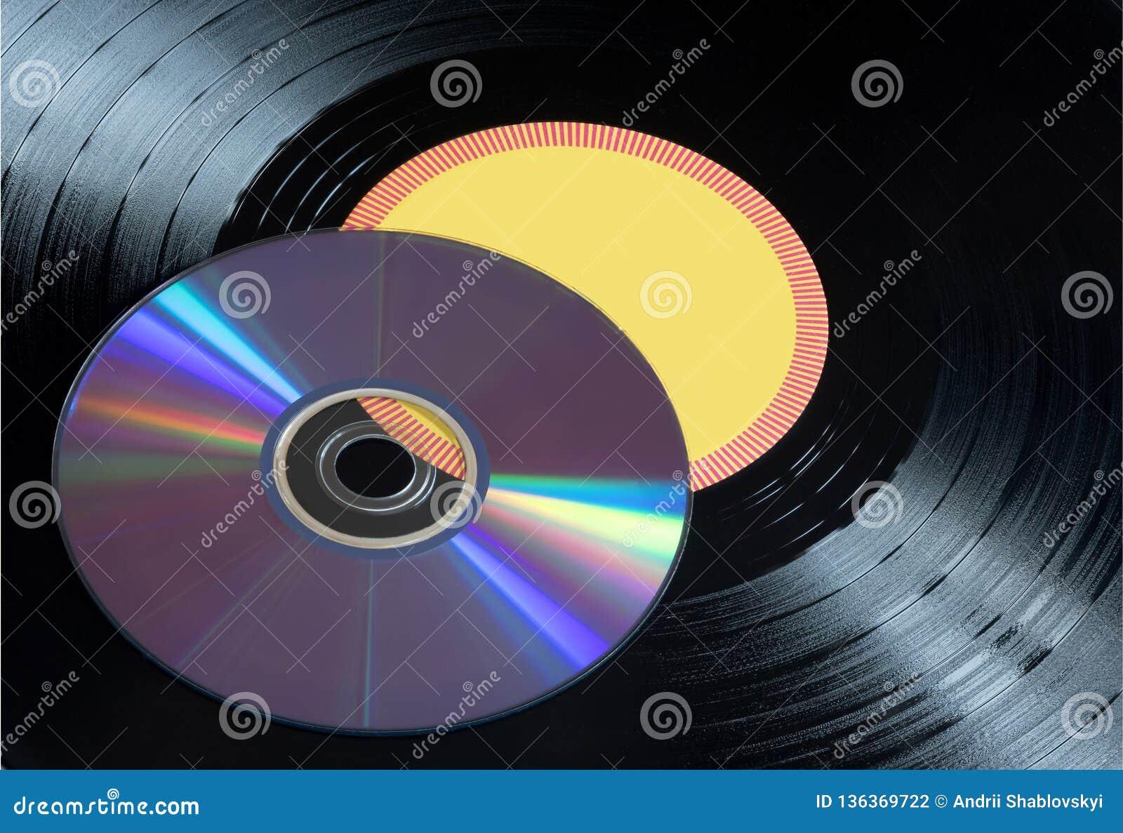 Vinyl records and CDs disks close up. Musical disks.