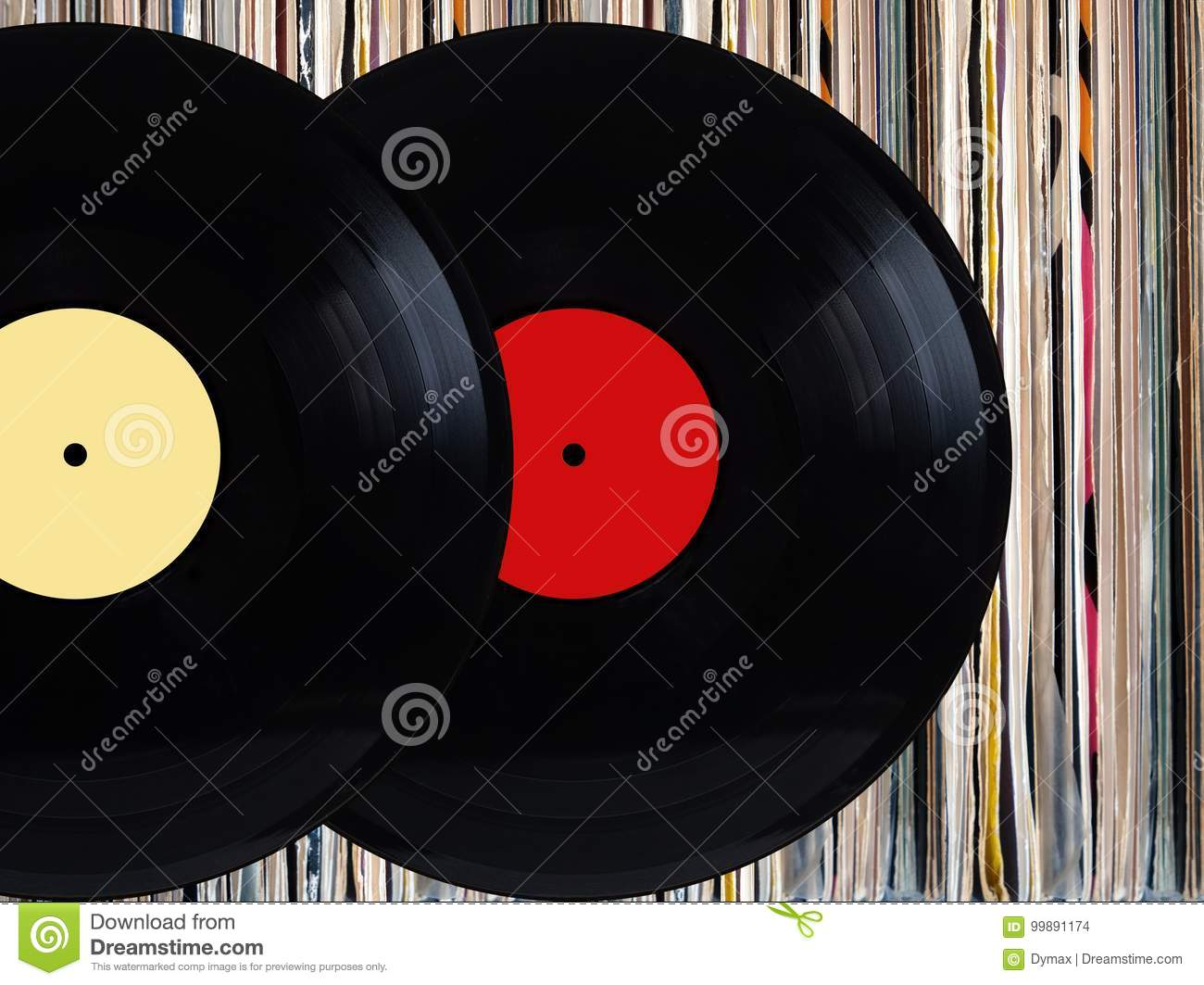 vinyl records in front of pile of many close standing vinyl disks in