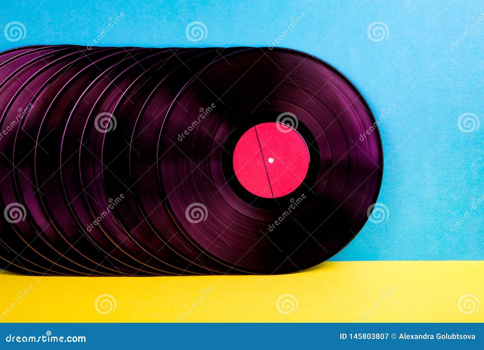 Vinyldisketten auf Hintergrund