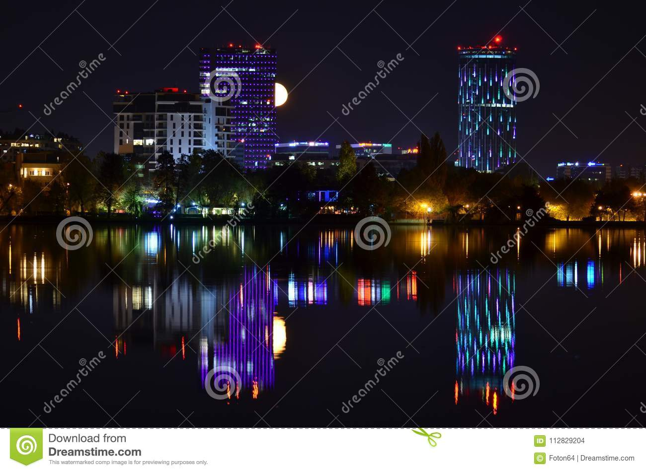 Violet lights night scene with full moon and water reflection