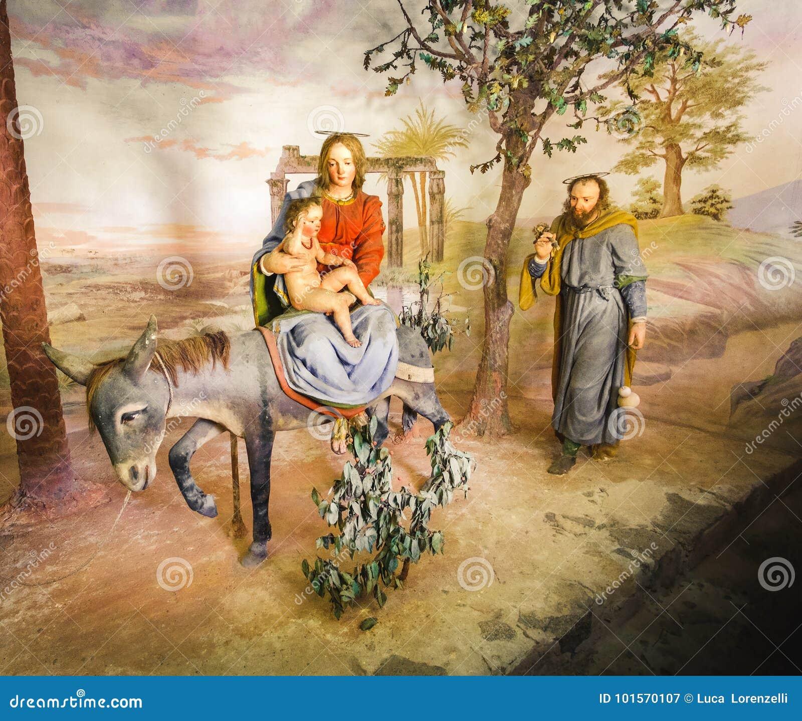 Virgin Mary και παιδί Χριστού στη βιβλική αντιπροσώπευση σκηνής της Αιγύπτου presepe