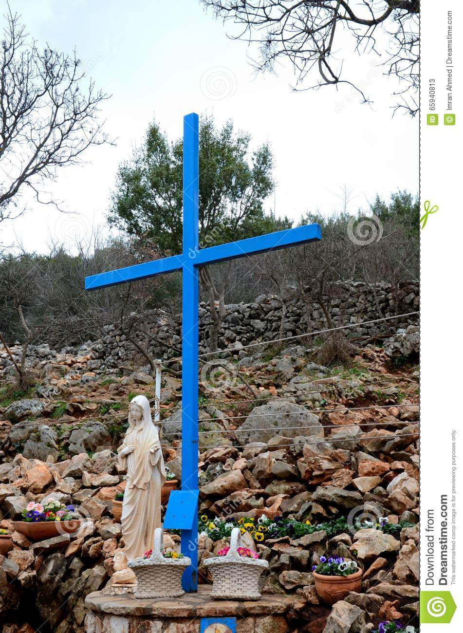 The Virgin Mary And Cross At Catholic Pilgrimage Site