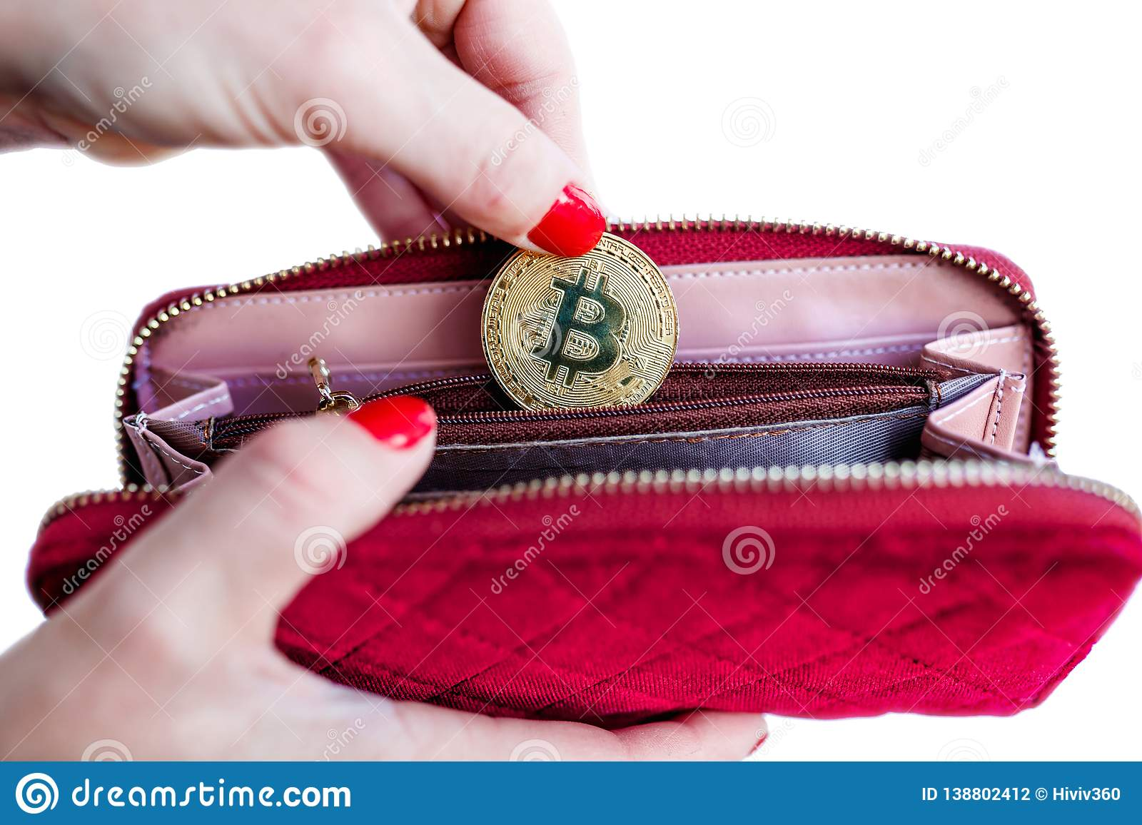 Virtual money golden bitcoin on pink women fabric purse. fingers with red nails on a coin isolated on white background