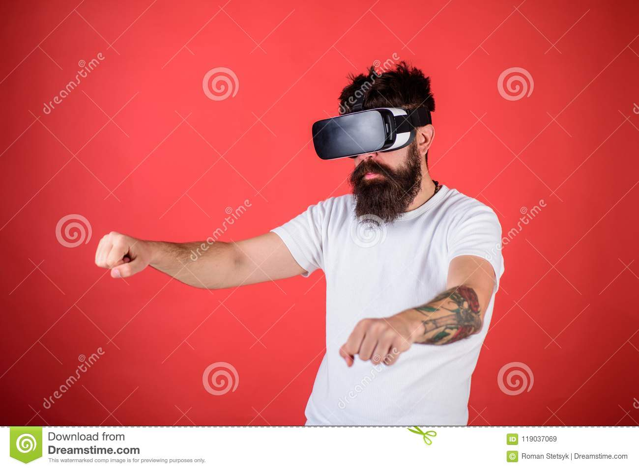 Virtual racing concept. Hipster on confident face driving bike on high speed in virtual reality. Man with beard in VR