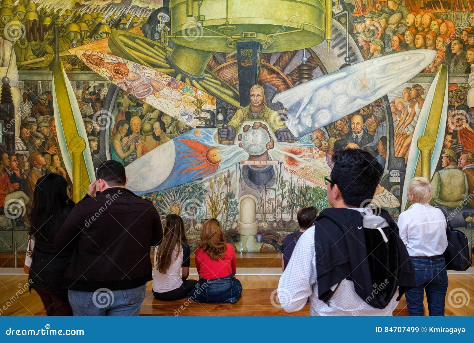 Visitors Admiring The Murals By Diego Rivera At The Palacio De