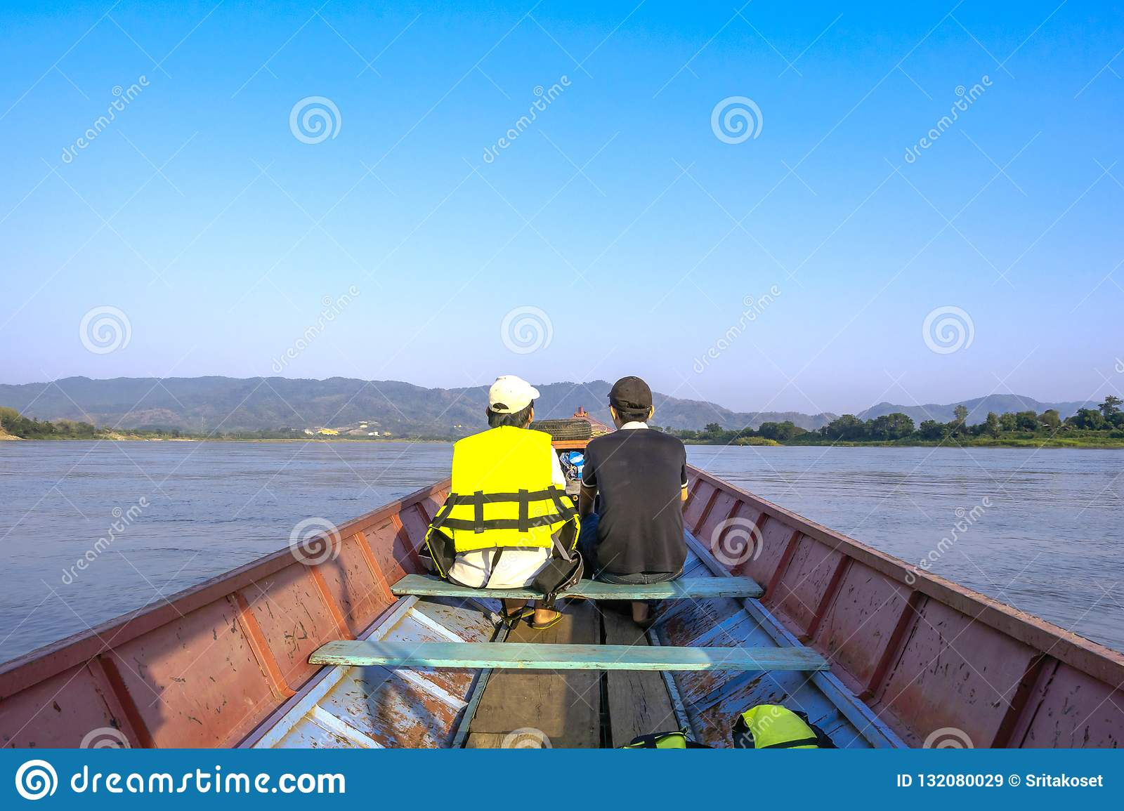 Visitors can take a small boat to see the nature along the Mekong River.
