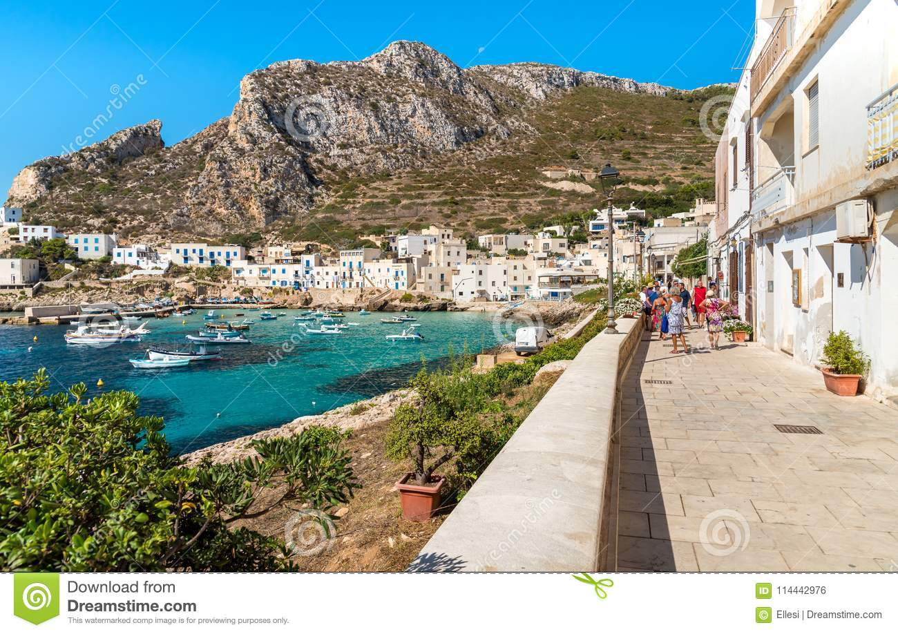 Visitors enjoy the coastline during their trip of small village on Levanzo island, the smallest of the Egadi.