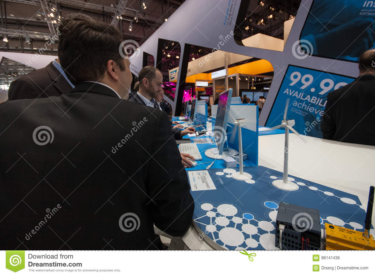 Visitors See Booth Of Software AG Company At CeBIT Editorial