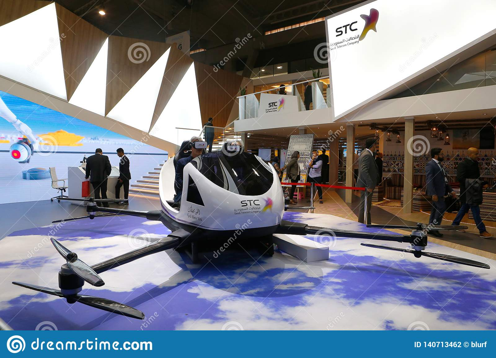 Visitors Testing VR Drone Experience At STC Booth In MWC