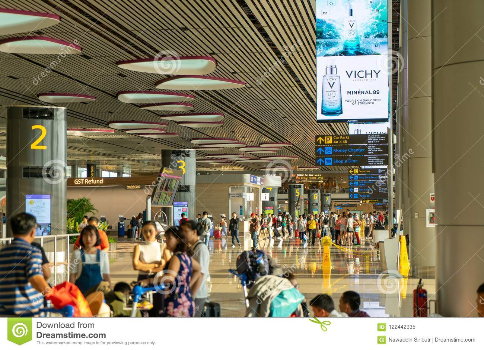 Visitors Walk Around Departure Hall In Changi Airport Singapore