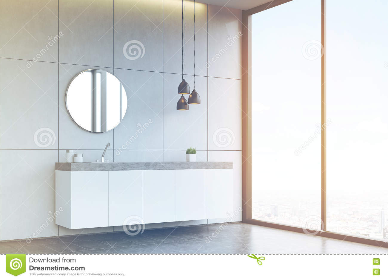 Vista laterale di un lavandino del bagno con lo specchio rotondo sulla parete piastrellata co - Specchio bagno rotondo ...