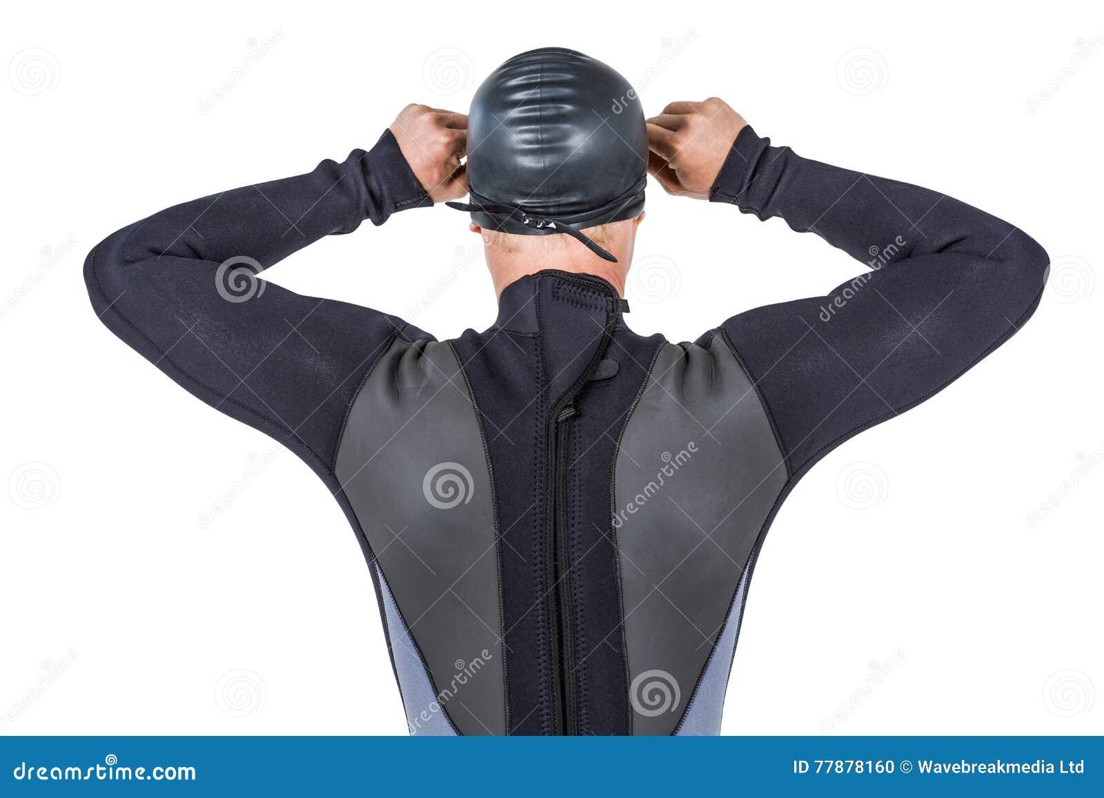 Vista Posterior Del Nadador En Gafas De La Natación Del Wetsuit Que Llevan Foto de archivo