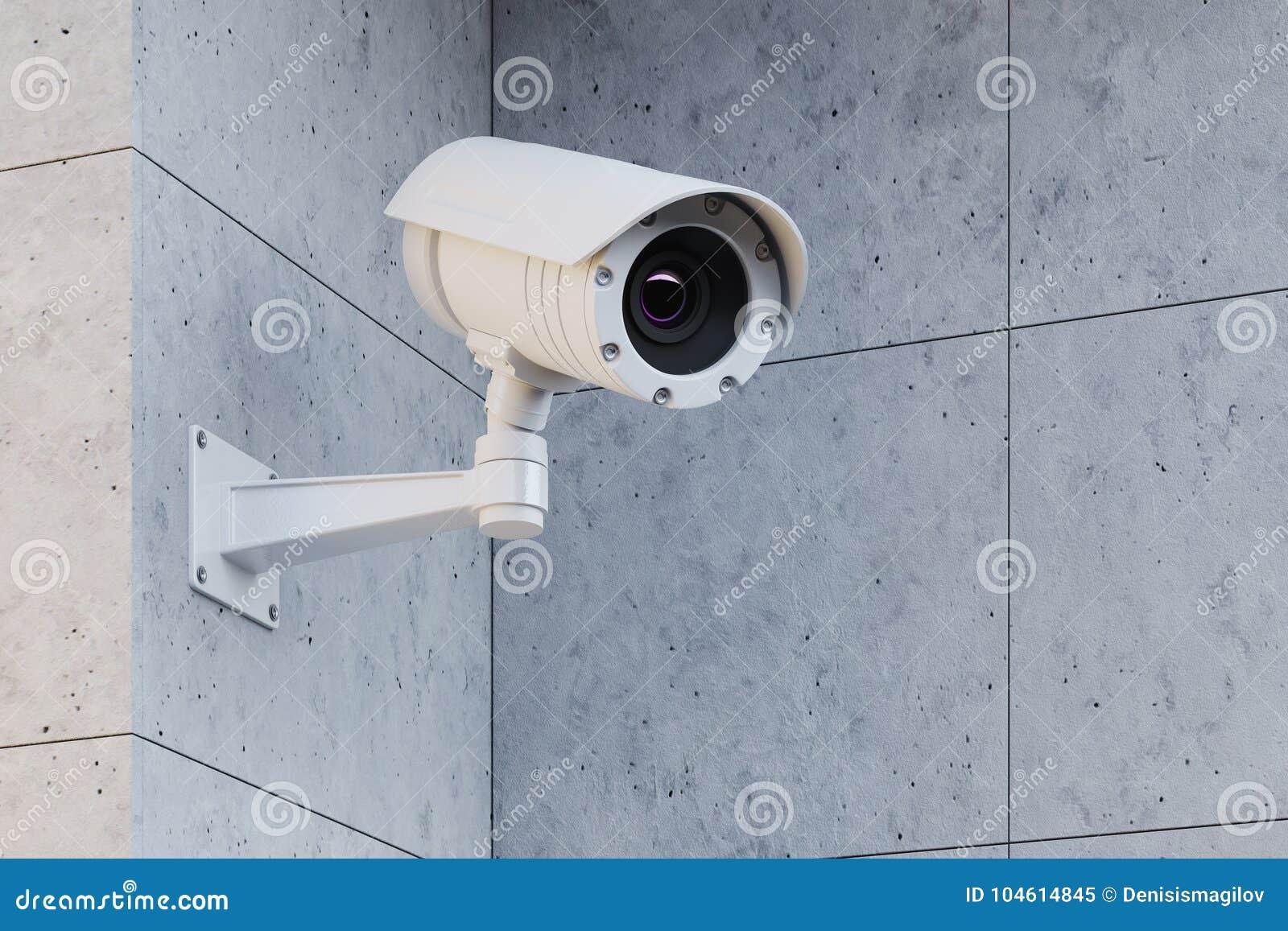 Vit CCTV-kamera på en grå vägg