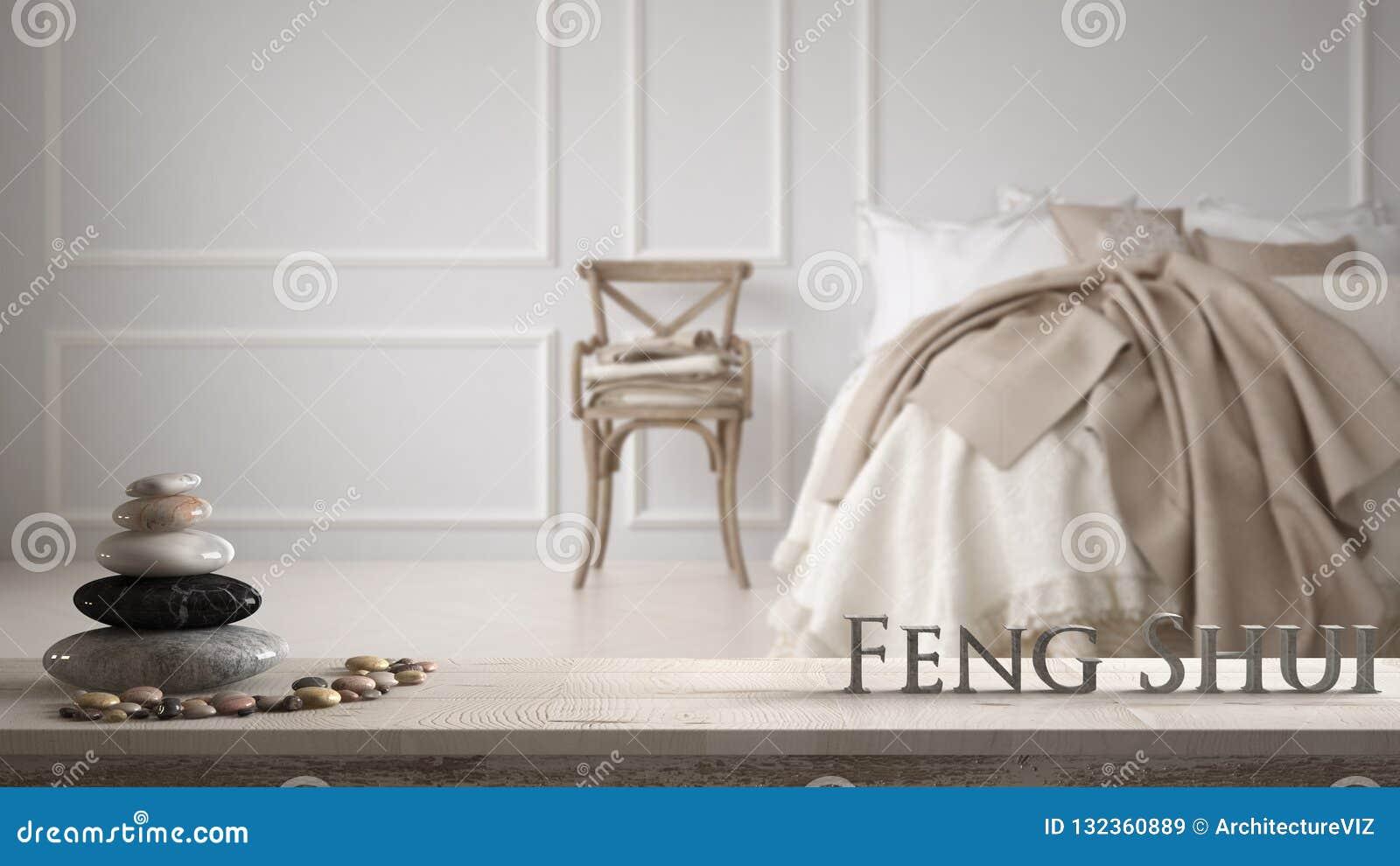 Vit tabellhylla med kiselstenjämvikt och bokstäver som 3d gör ordfengshuien över klassiskt sovrum för evintage med mjuk säng full