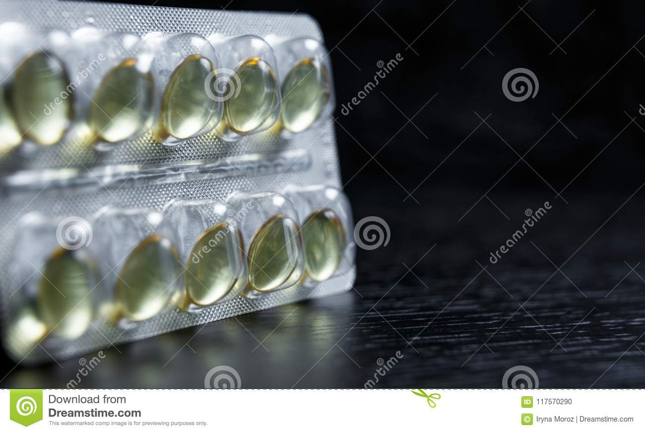Vitamin D capsules. blister pack with vitamins. Pharmaceutical