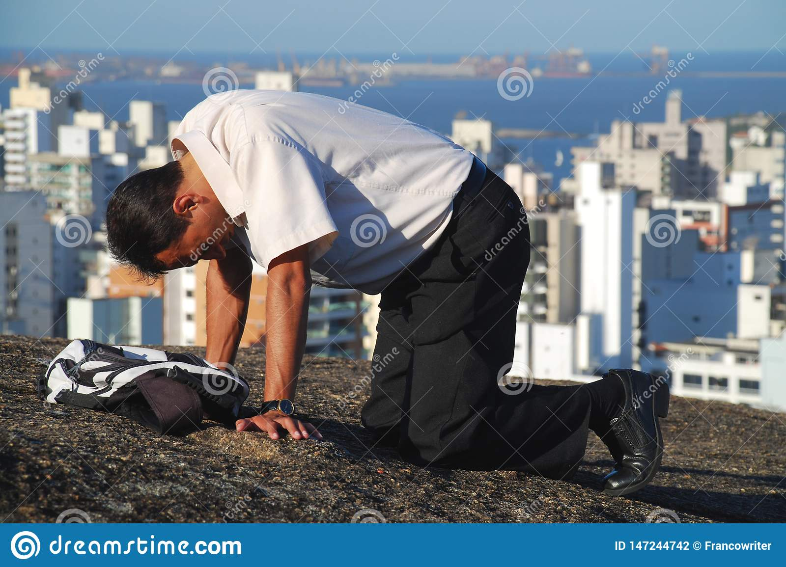 Man Praying over the Mountain in Brazil