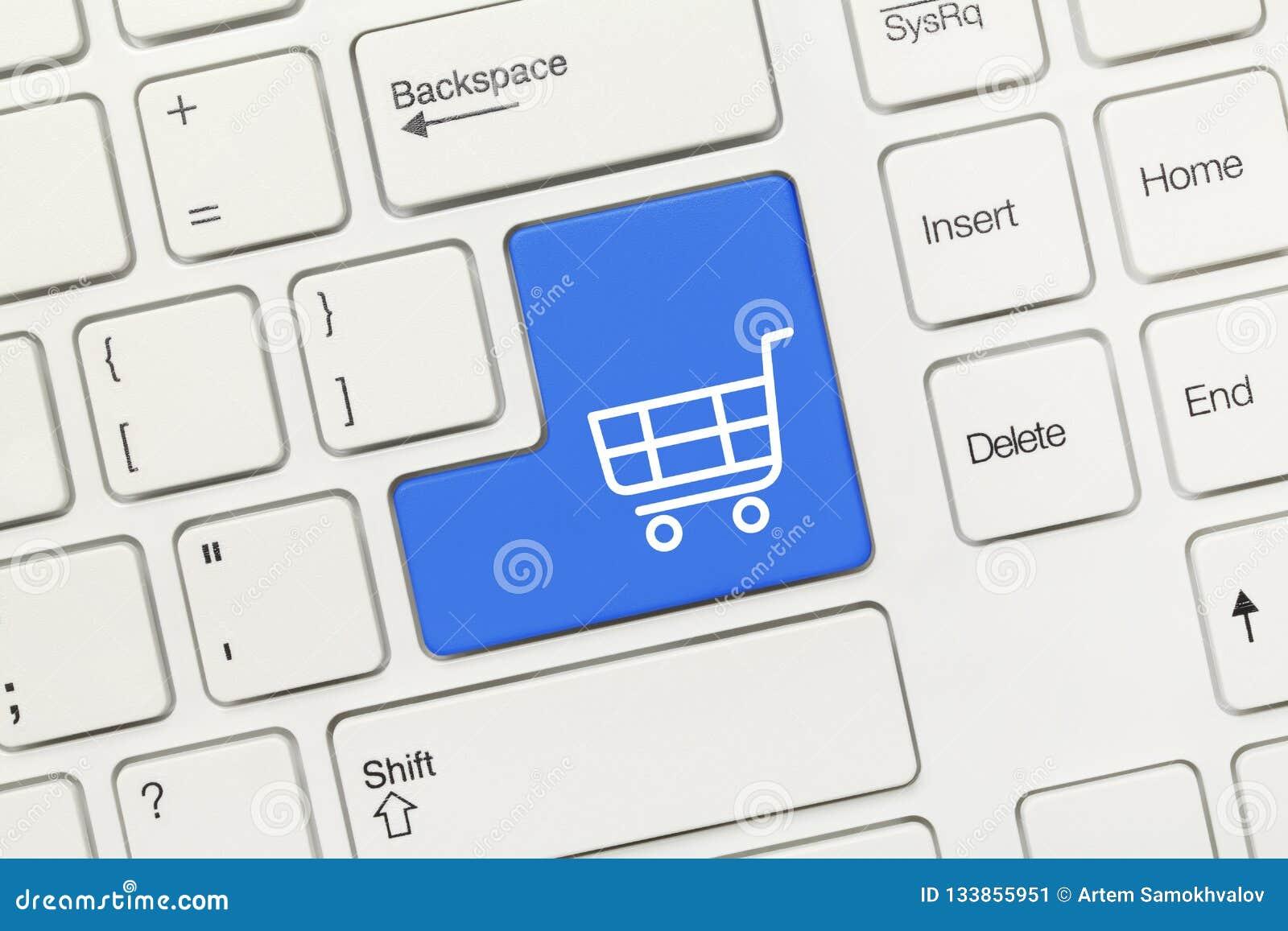 Vitt begreppsmässigt tangentbord - tangent för symbol för shoppingvagn blå