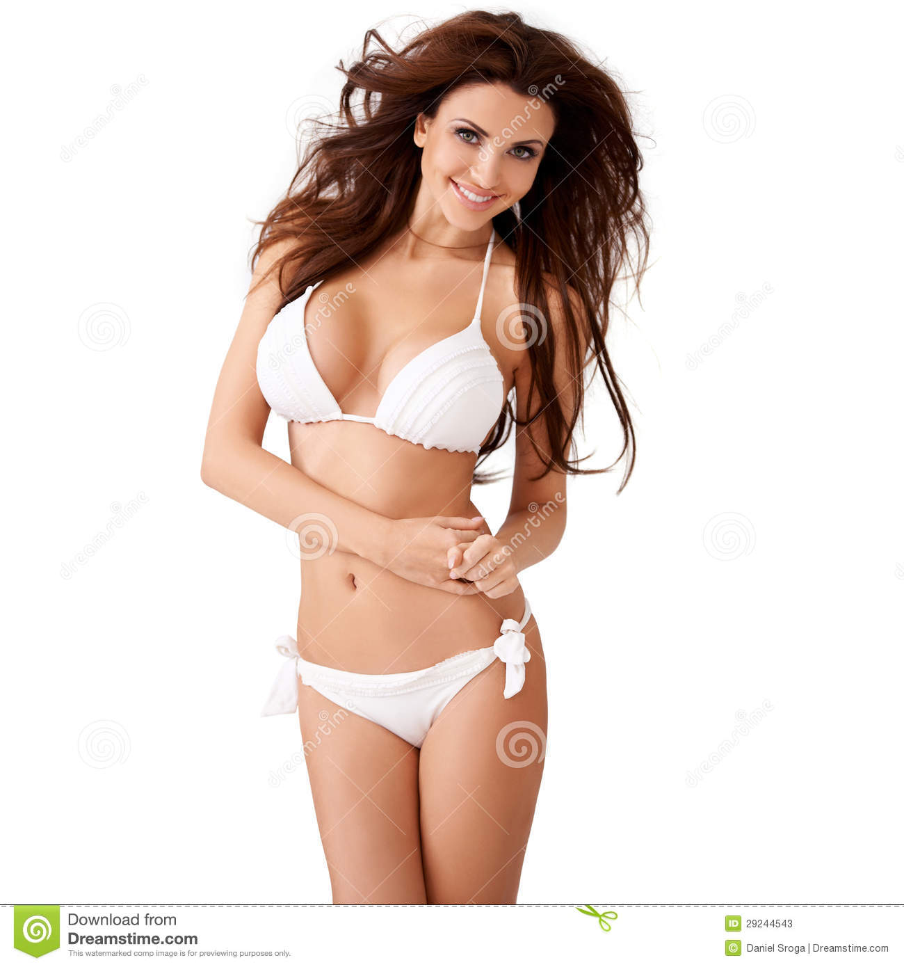 Vivacious young brunette woman with a beautiful smile and her hair blowing  in the breeze posing in a white bikini three quarter isolated studio  portrait edde6e2d6434