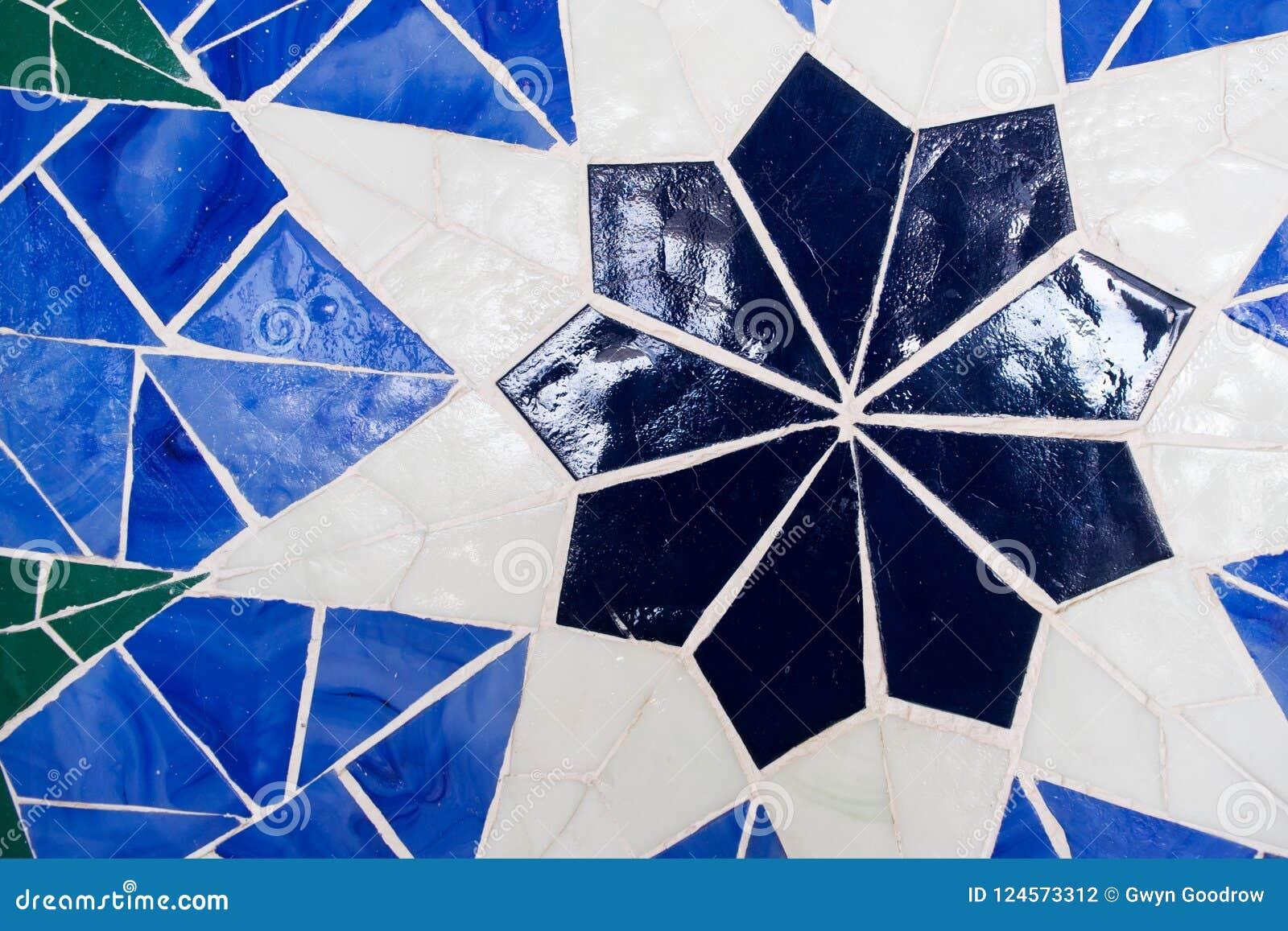 Vivid blue kaleidoscope background. Painted geometric pattern.