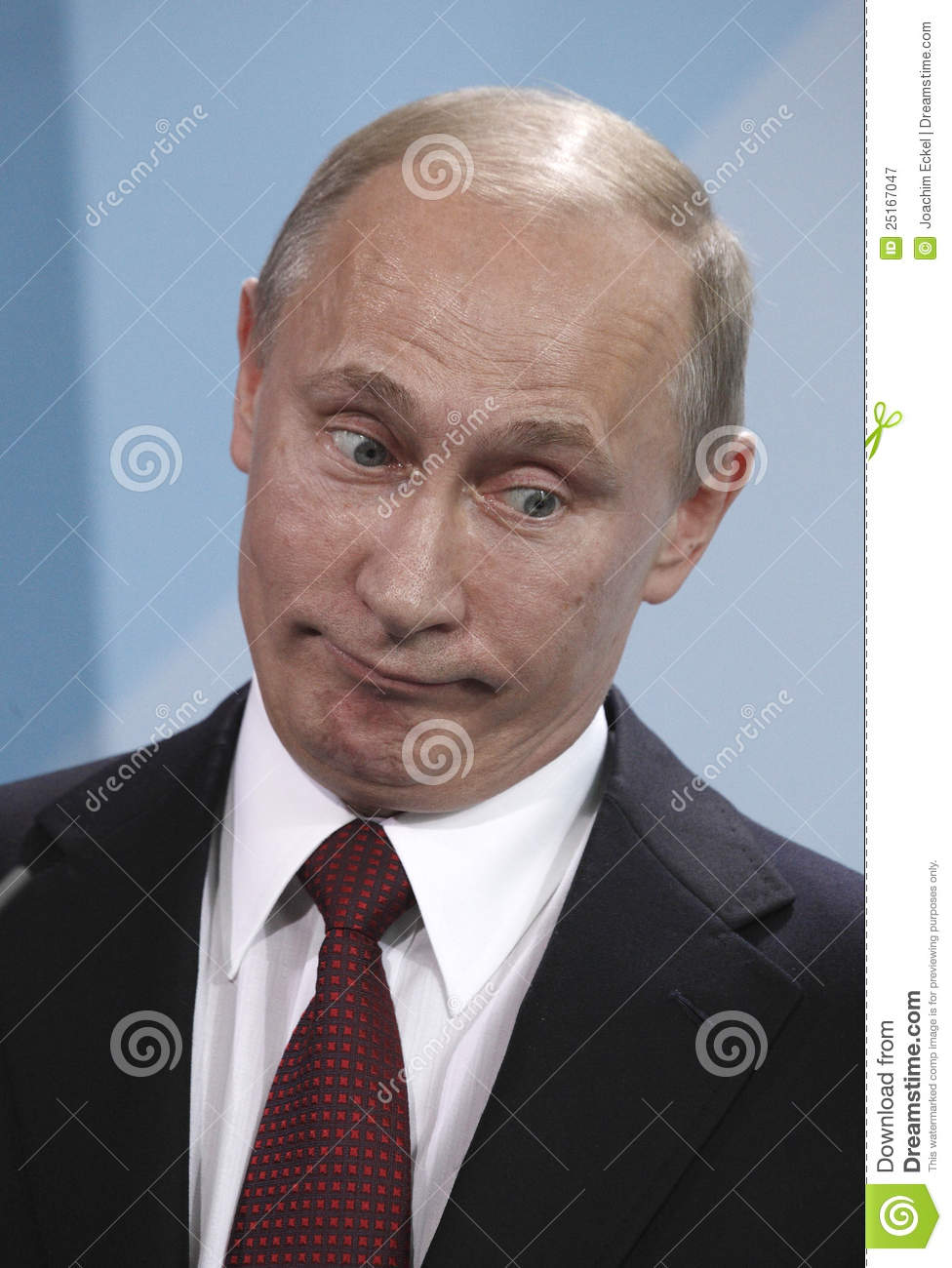 Russian President Vladimir Putin reacts during a news conference after ...