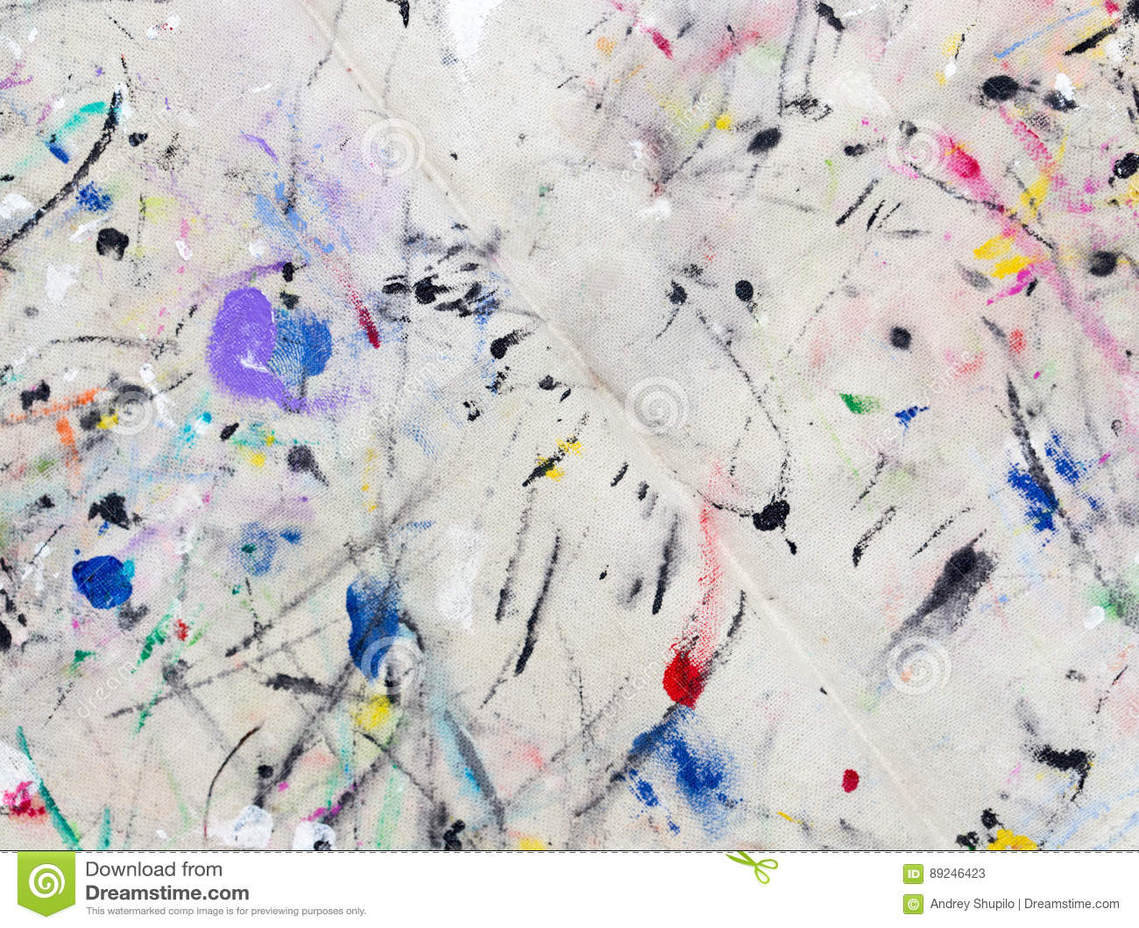 Vlekken van gekleurde verf op stof