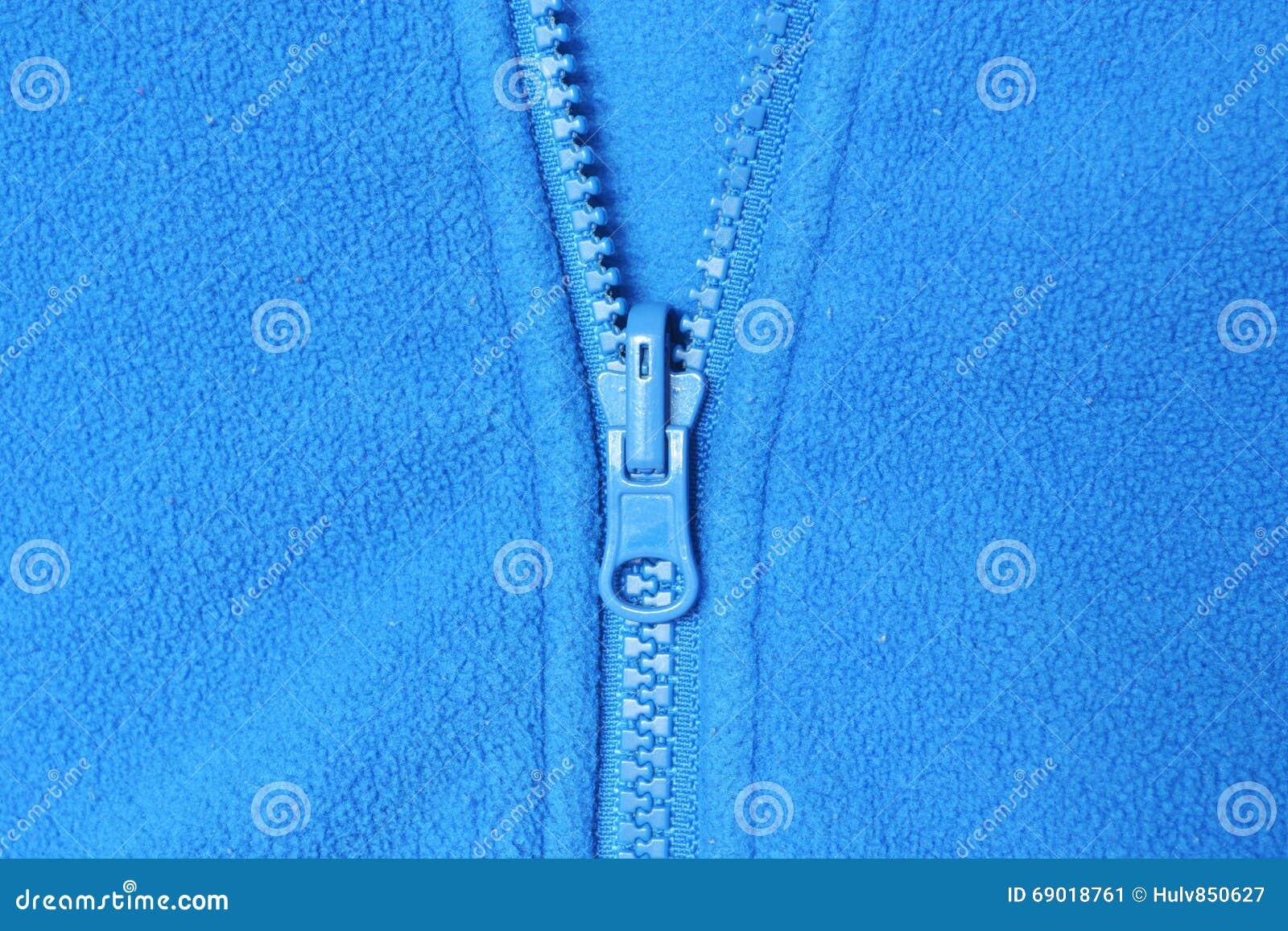 Vlies und blauer Reißverschluss