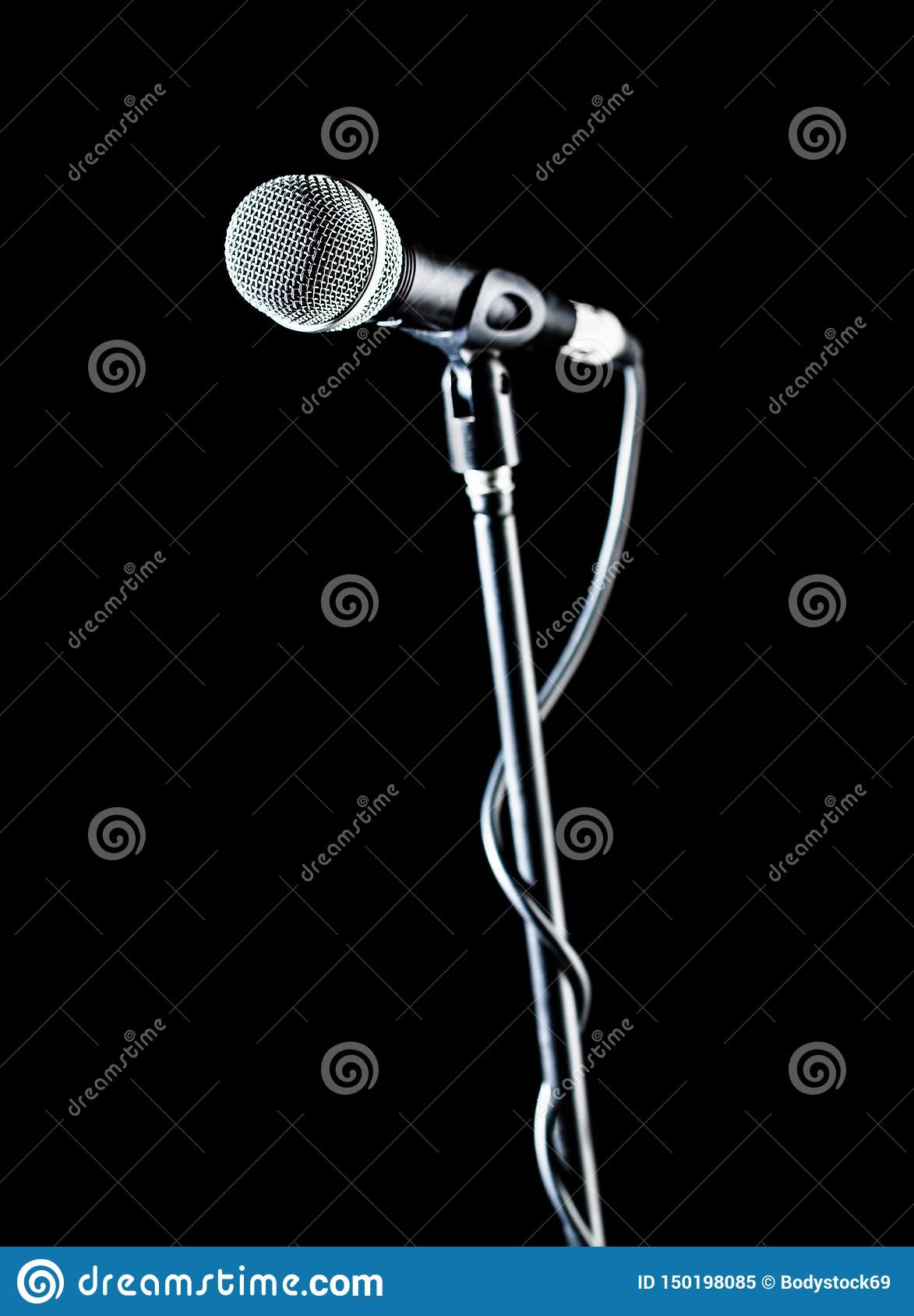 Vocal audio mic on a bleck background. Audio equipment. Karaoke concert, sing sound. Singer in karaokes, microphones