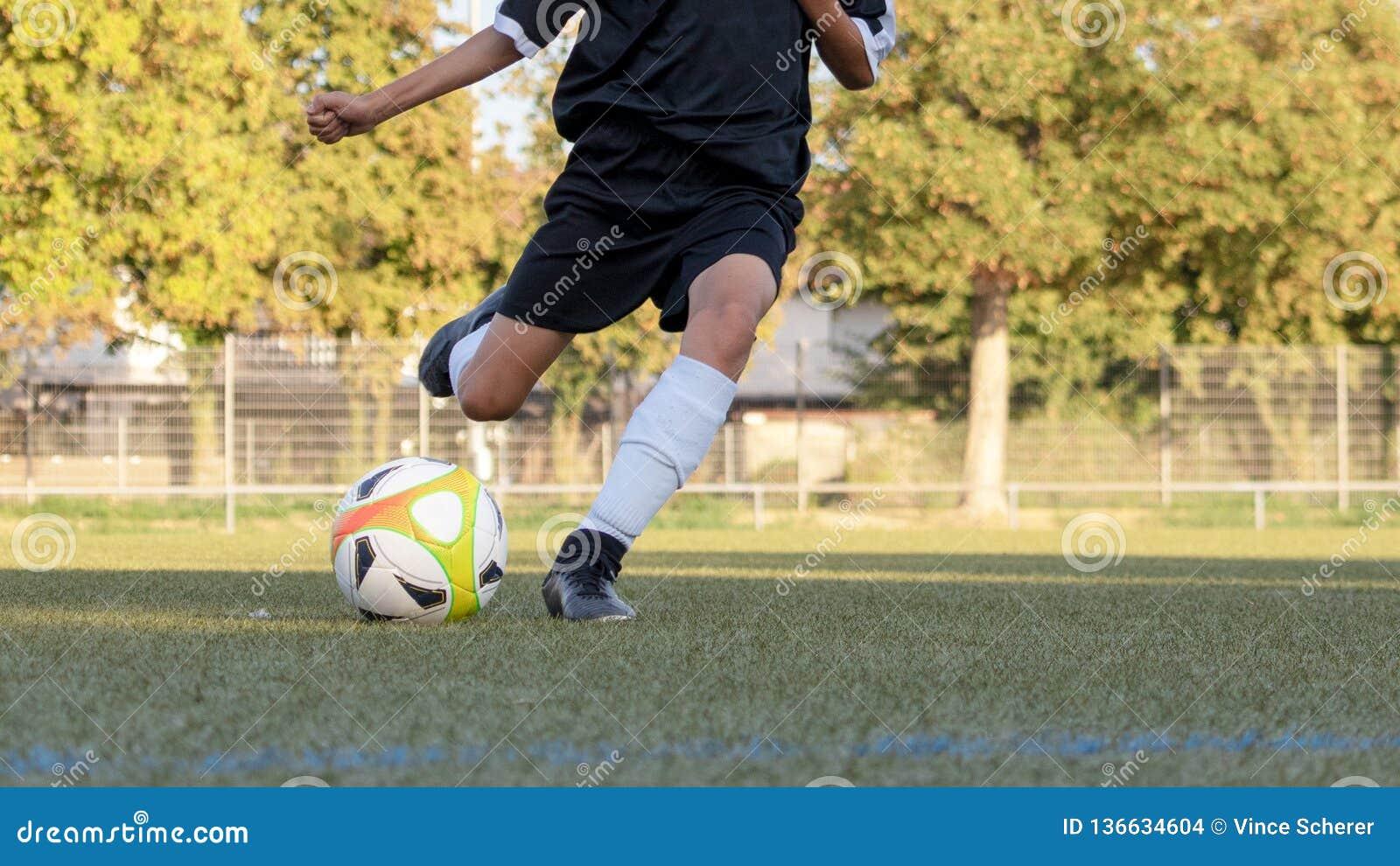 Voetballer in actieclose-up