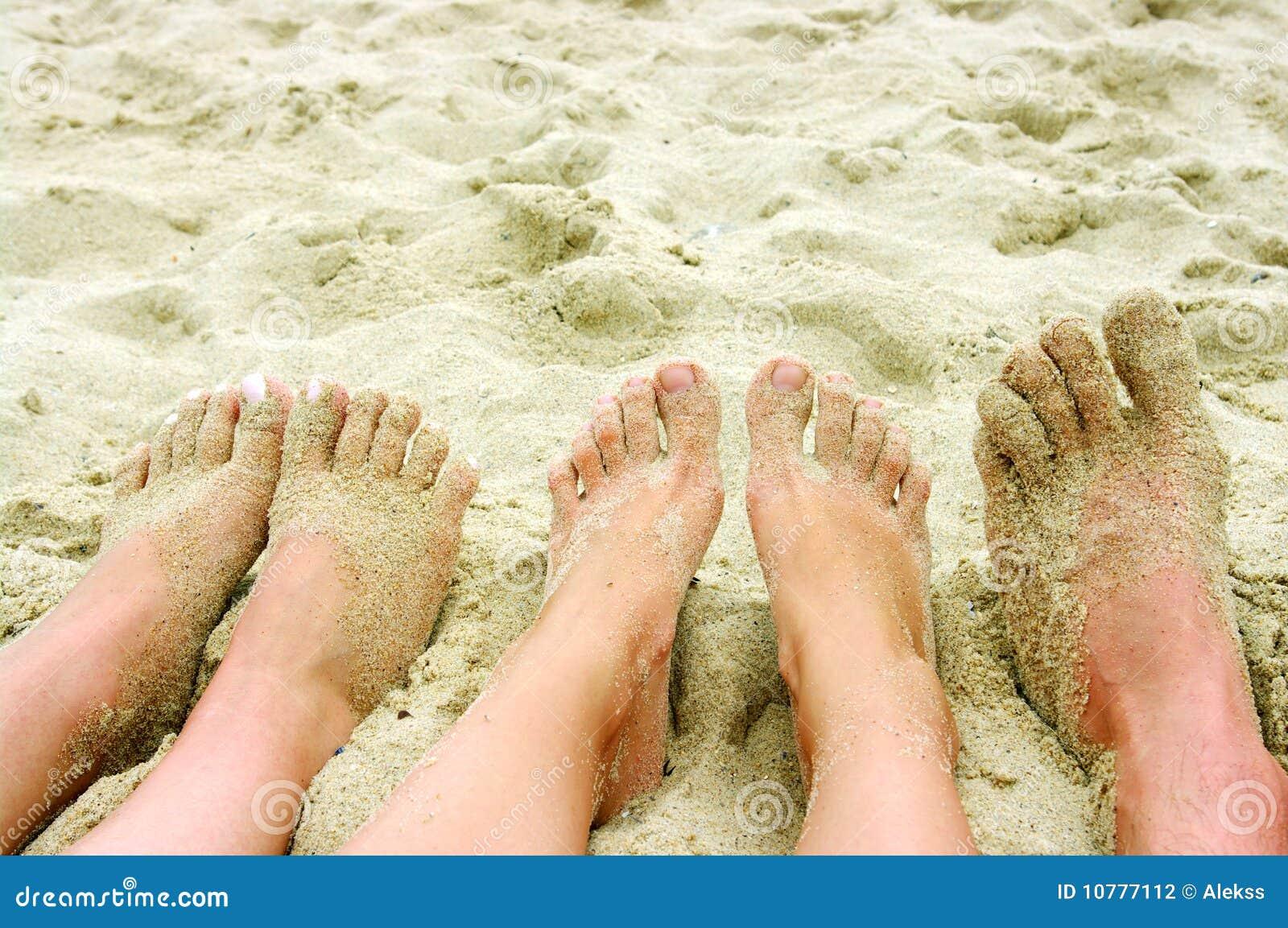 Voeten op een strand