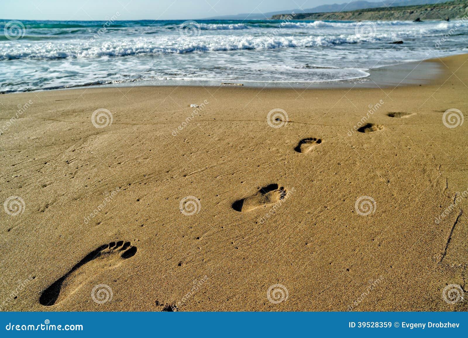 Voetstappen op het zand