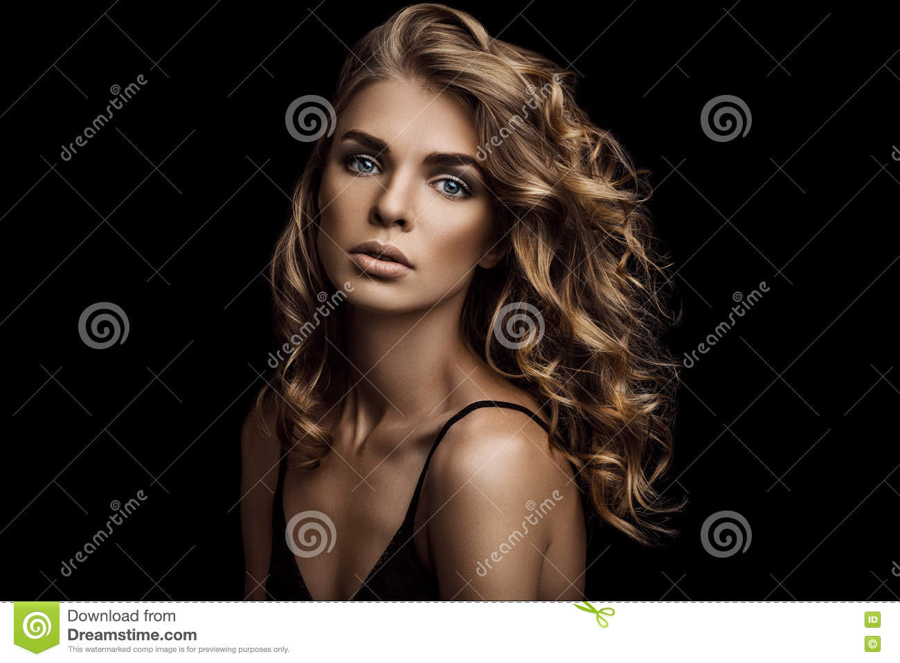 Vogue style close-up portrait of beautiful woman with long curly hair