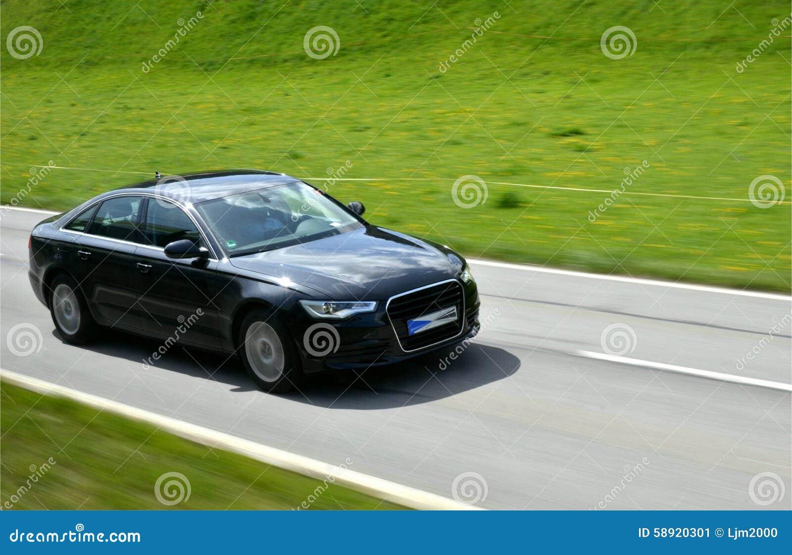 voiture de luxe sur une route photo stock image 58920301. Black Bedroom Furniture Sets. Home Design Ideas