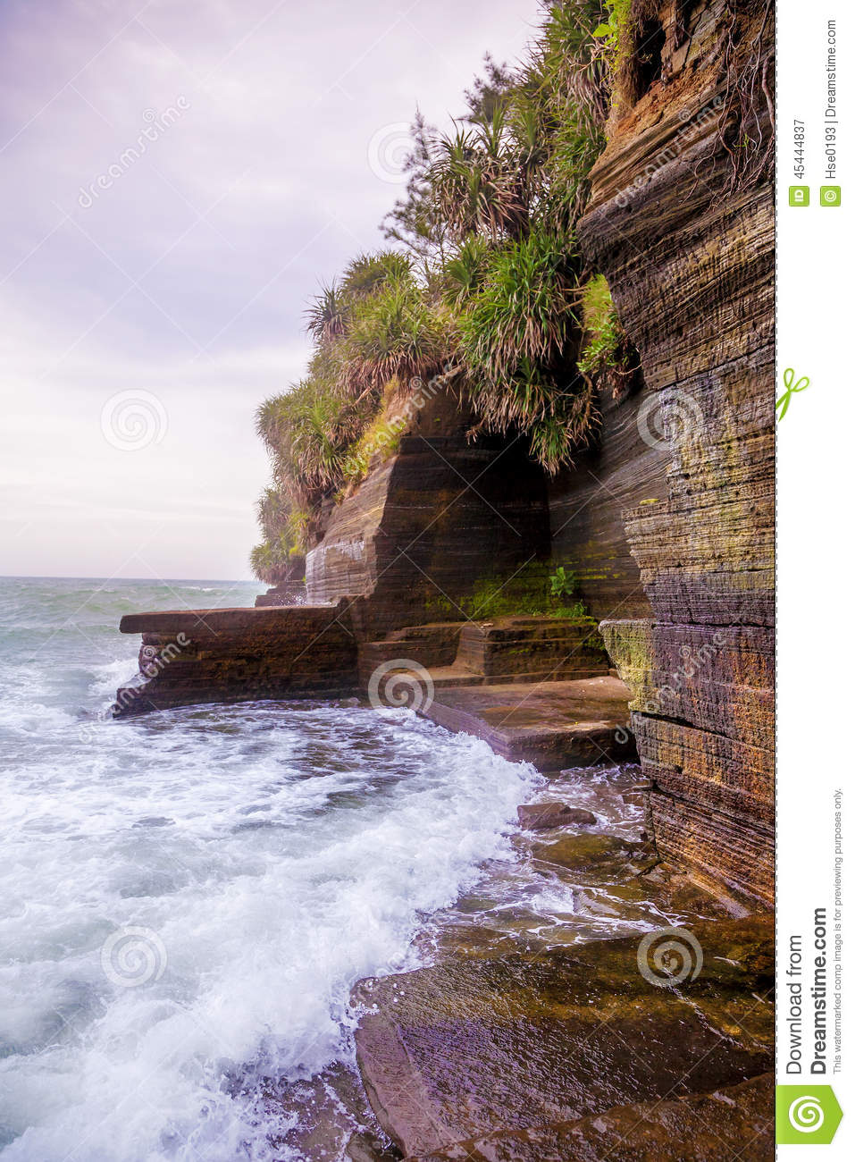 Volcanic cliff with sea waves