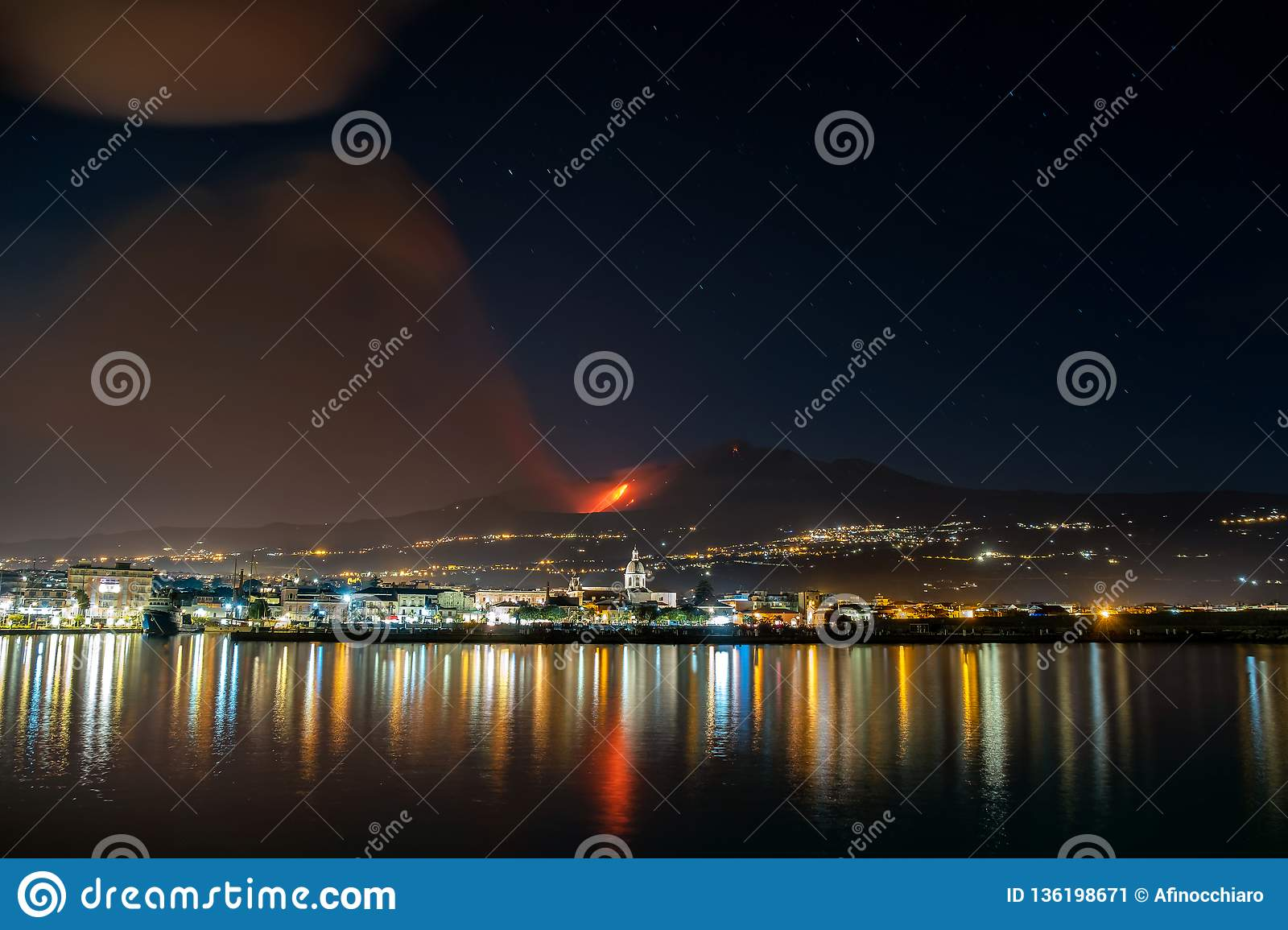 Volcanic eruption and ash plume at nighttime