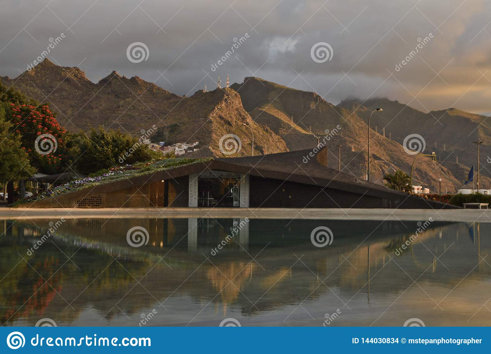 Volcanic mountains and modern building Tenerife Canary Islands