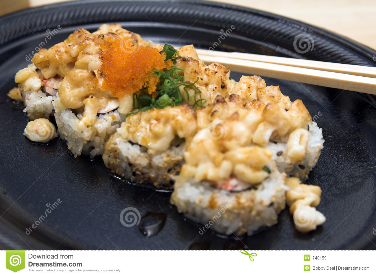Volcano sushi roll, California roll with baked scallops and smelt roe ...