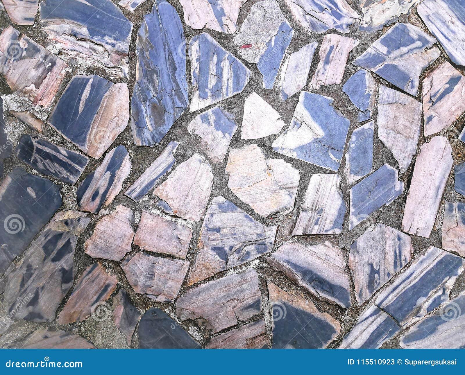 Voller Rahmen-Hintergrund des mit Ziegeln gedeckten Steinbodens