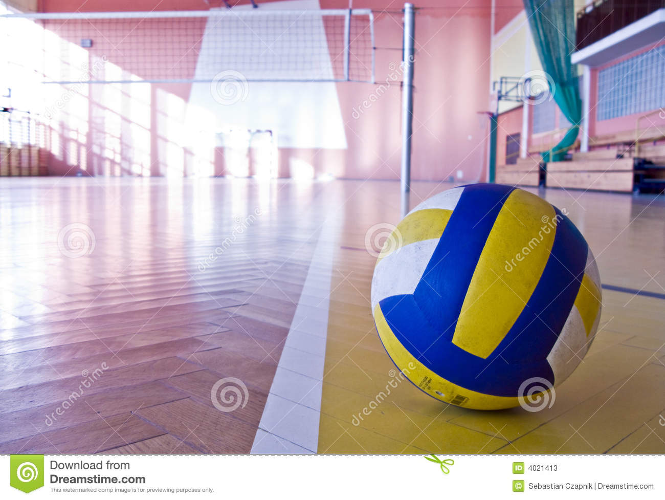 Volleyball in a gym on the floor clouseup