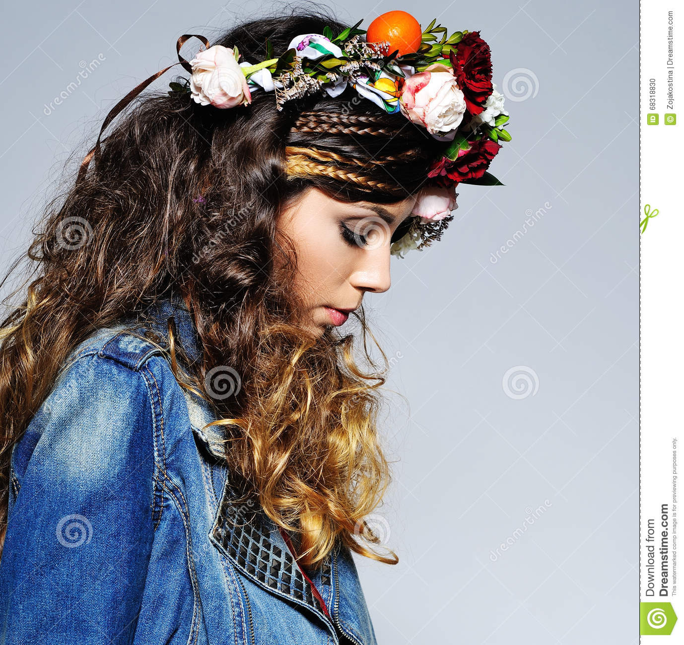 Volume hair with braids and flower crown stock photo image of boho fashion portrait of a beautiful young woman with gipsy hairstyle wearing handmade statement flower crown and trendy jeans outfit izmirmasajfo